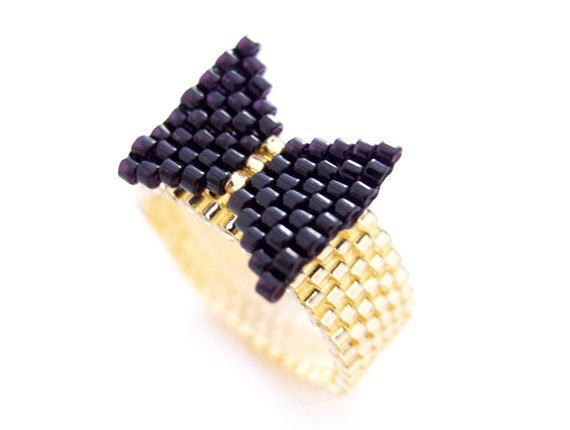 Black Bow Ring in black and gold band by JeannieRichard on Etsy, $35.00