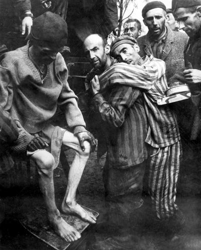 """Wobbelin Concentration Camp, Germany, WWII. This is a picture of the prisoners being """"discovered"""" and taken to the hospital."""