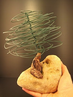 love this 'junk' tree with wire, wood and stone