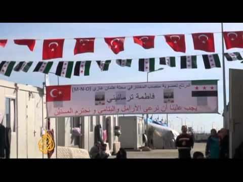 Syrian refugees living at the Kilis camp in Turkey, are holding an election.     They are choosing a council that will run the camp along with Turkish officials.     Women are entering the political fray for the first time.     Although the elections are largely symbolic, these elections are hoped to expose the refugees to challenges they may face whe...