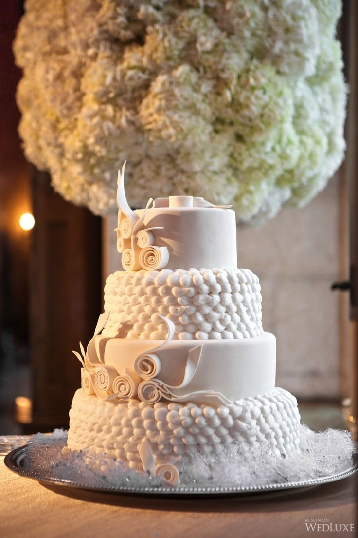 A beautiful four-tier white #wedding #cake  | Photography by: PhotoPhilCro…