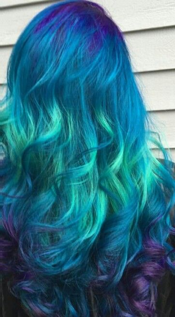 Turquoise green blue dyed hair with a hint of purple