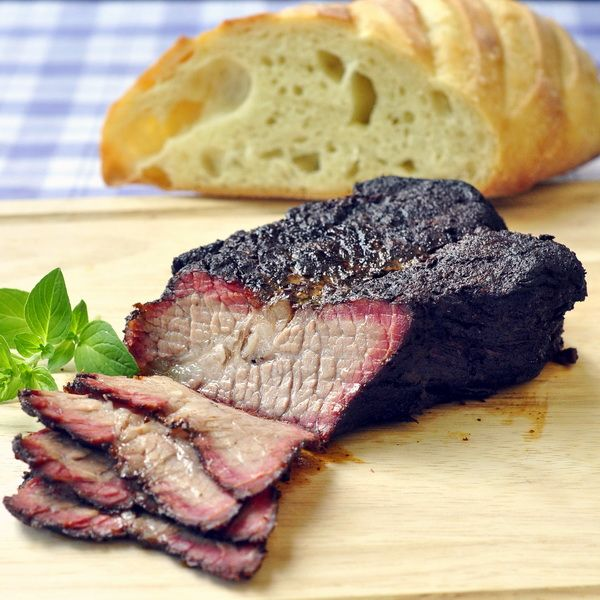 Smoked Beef Brisket - dry rubbed and very slowly barbequed to tender beef brisket perfection. This recipe includes an alternative partial oven method to avoid having to tend it all day long.