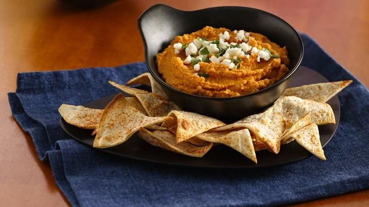 An easy flavorful hummus dip with homemade tortilla chips.
