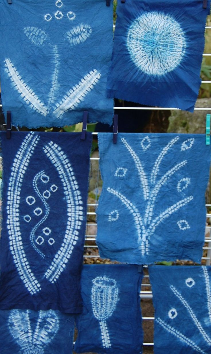 A selection of shibori created patterns made on Annabel Wilson's indigo workshop.