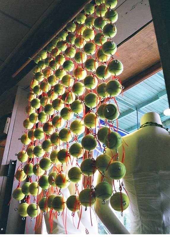 Tennis balls make up this hanging wall!
