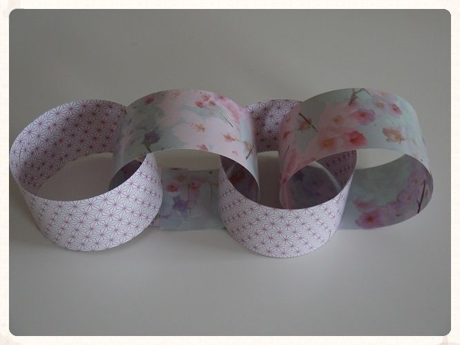 These unique giant floral and patterned purple pink and light blue paper chains would look great draped along the ceiling walls or even the back of
