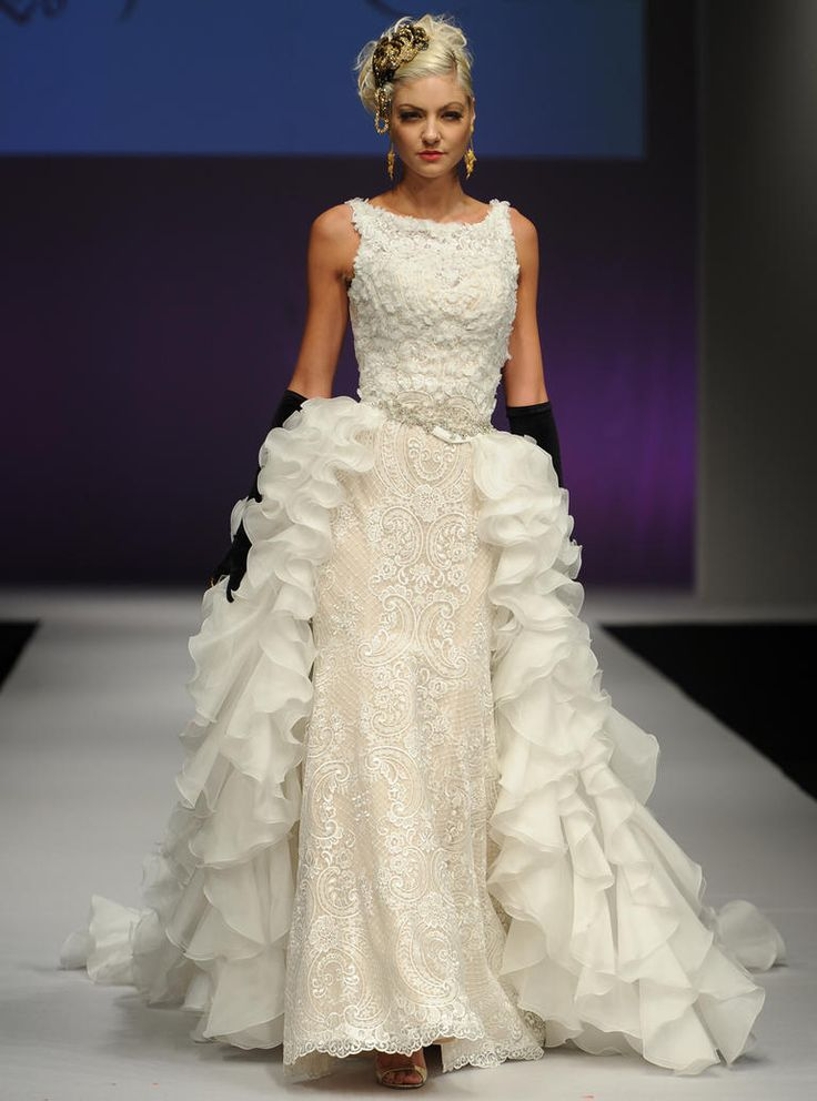 Yumi Katsura Fall 2016 illusion neckline wedding dress with lace detailing, crystal sash and ruffled overskirt | https://www.theknot.com/content/yumi-katsura-wedding-dresses-bridal-fashion-week-fall-2016