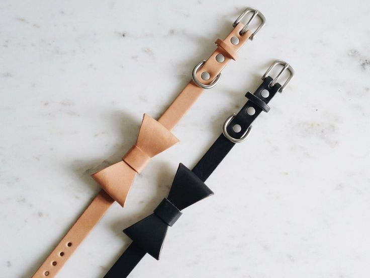 Bowtie collar made from natural vegetable tanned leather and solid brass hardware. Colors: Oak and Black leather. Size: Available in one size only. For neck sizes 11.5-15.5 in, 29-39 cm.