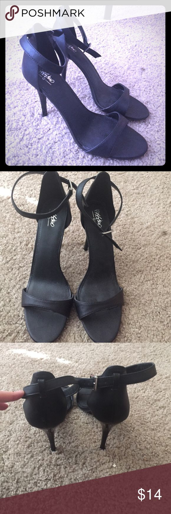Black strap heels Awesome black heels! Only worn once! Great condition! Let me know if you have any questions! I accept reasonable offers! Mossimo Supply Co Shoes Heels