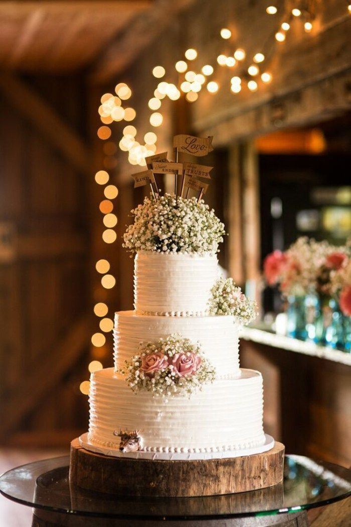 Romantic and rustic wedding cake with baby's breath topper | See more: http://mysweetengagement.com/15-extraordinary-wedding-cakes-for-all-wedding-styles