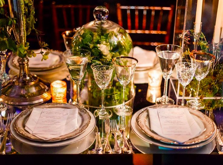 """""""I love the tablescapes because they featured so many different centerpieces that each chair's view was different from its neighbors."""" #wedding #feteny #reception #flowers #tabletop #placesetting"""