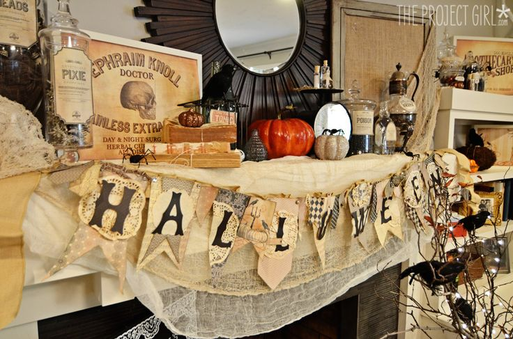 Can't believe I'm pinning Halloween already. I LOVE the creepy vintage and black mantel!