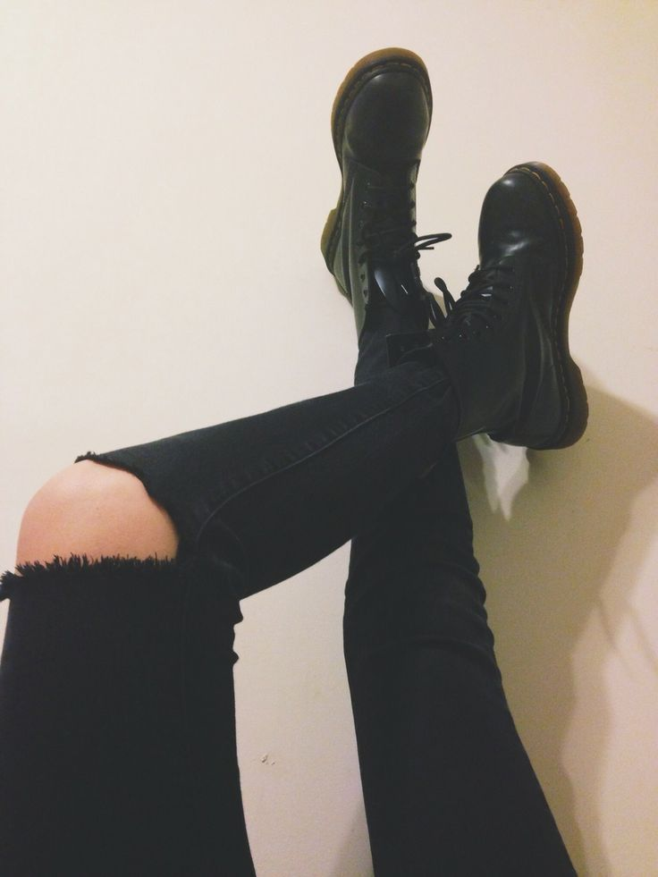 Ripped black skinny jeans with black lace-up Doc Marten style boots