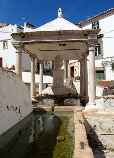 The Land of Jews: Castelo de Vide - Fonte da Vila, the ex-libris of the village, is one of several sources of the town`s curative waters, a carved stone fountain with a pillared canopy. Just above is the maze like Jewish quarter #Marvao #Alentejo #Portugal