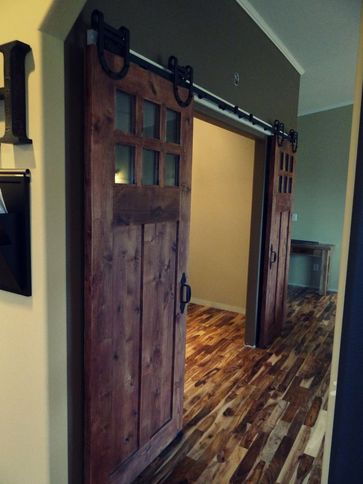 Sophisticated double barn doors interior with glass top for Barn doors over sliding glass doors