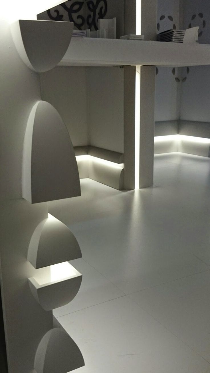 multifunctional molding profile shown installed in variety of ways with LED lighting, providing a subtle illumination to a space