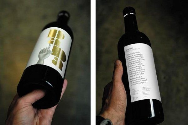 Suckers for a good typeface will fall for the design of Dada Wine in a heartbeat.  This progressive bottle design features a fresh, bubbly, bold and golden logo taking up most of the front label space.  The signature Dada hand supports the logo, while the business end of this design is moved to the back, justified to the left.
