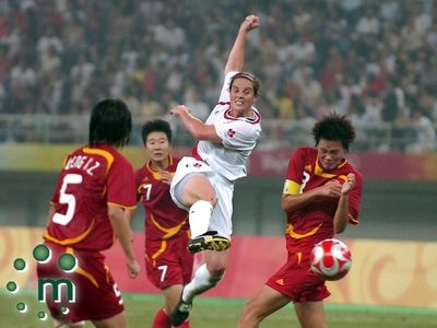 A good ripper. Rhian Wilkinson of the Canadian women's soccer team rips the ball through several players from China during first half action at the Tianjin Olympic Centre Stadium