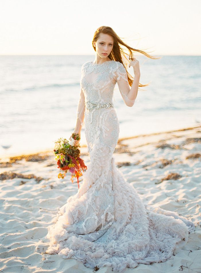 I like something about thi dress. Not the whole deal but something.   Warm Coastal Wedding Inspiration | Wedding Ideas | Oncewed.com