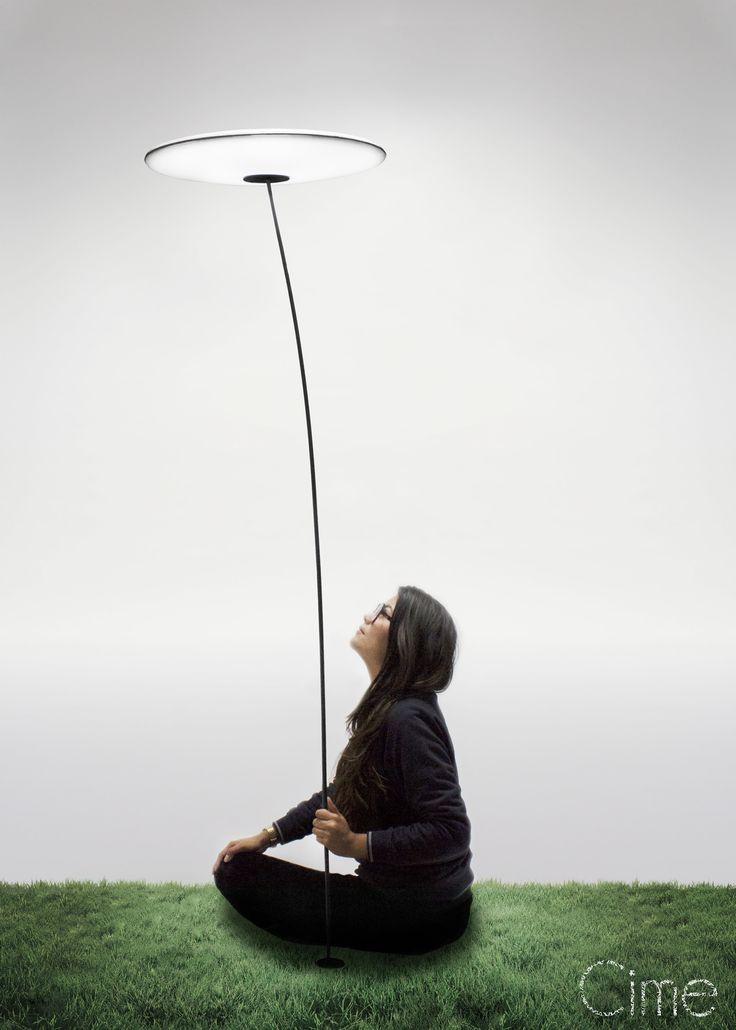 « Cime », c'est une vibration lumineuse, un léger balancement...  Ce luminaire prend tout son sens lorsqu'il s'élève du sol, en équilibre, à la manière d'une assiette chinoise.  Le disque Lumineux se positionne sur une tige de carbone qui disparaît dans la nuit. « Cime » est pensé pour être planté dans un jardin, puis multiplié.  L'utilisateur peut ainsi éclairer et composer librement son espace de vie extérieur.