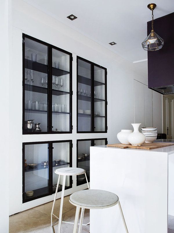 Recessed black metal framed kitchen cabinets - ingenious use of space