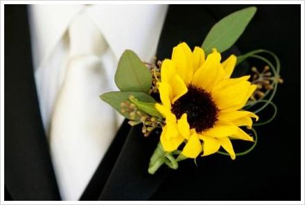 sunflower designer buttonhole idea- perhaps just for the groom                                                                                                                                                     More