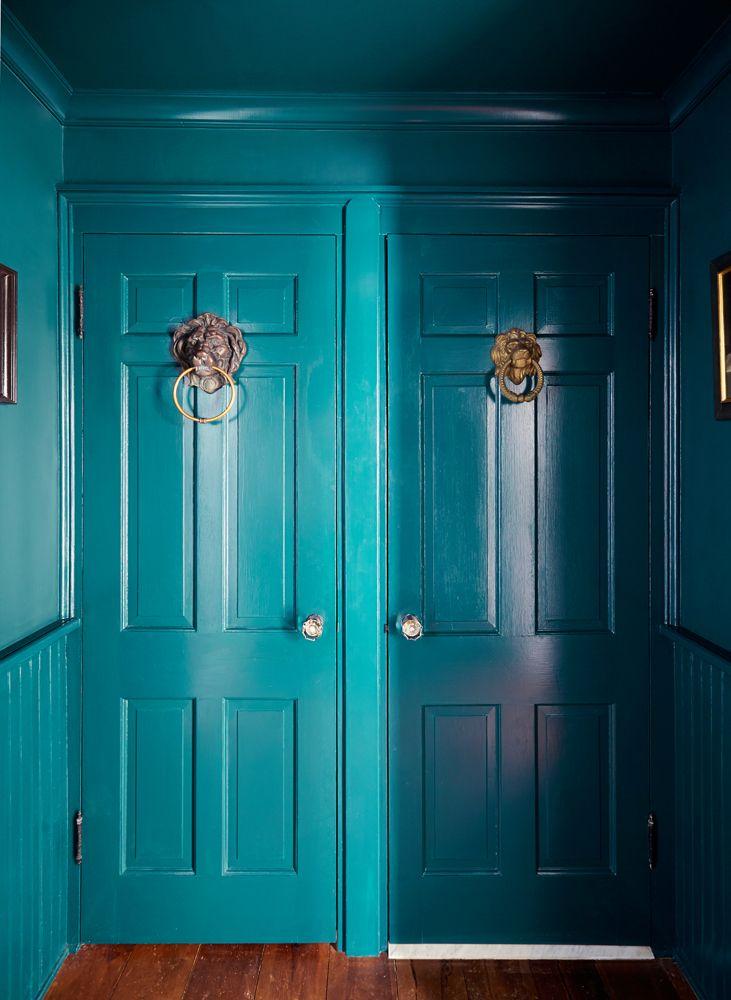 Teal doors hallway painted ceiling