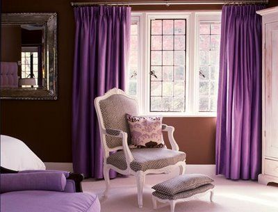 I like how the wall is one solid color, the furniture is another plain solid color, and then you have purple here and there. I sort of like the curtains.