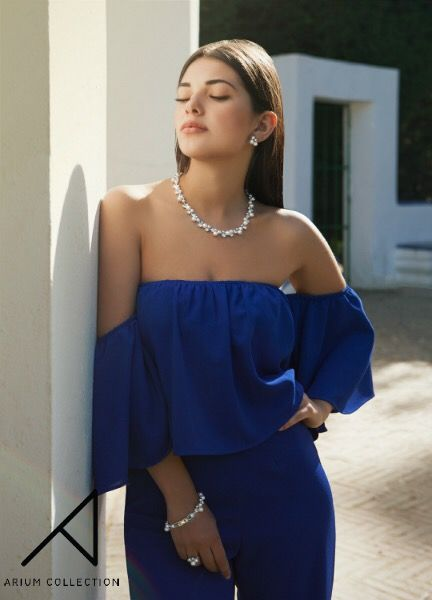 Model Eva Bueno wears the necklace, bracelet and earrings from our Morning Dew Collection on a sunny day in Sevilla.    Materials: rhodium plated brass, Swarovski crystal cream pearls and Swarovski crystals.  #ariumcollection #handcraftedjewelry #fashionshoot #swarowski