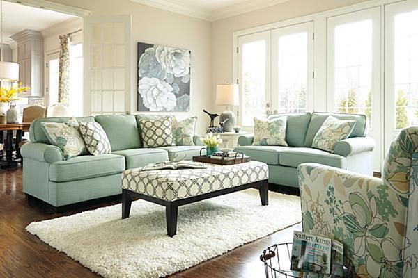 "The Daystar Sofa from Ashley Furniture HomeStore (AFHS.com). The ""Daystar-Seafoam"" upholstery collection features stylishly shaped set-back arms along with the supportive seat and back cushion beautifully adorned with welt detailing to create an inviting contemporary styled collection that offers a refreshing look and the comfort perfect to enhance any living area."