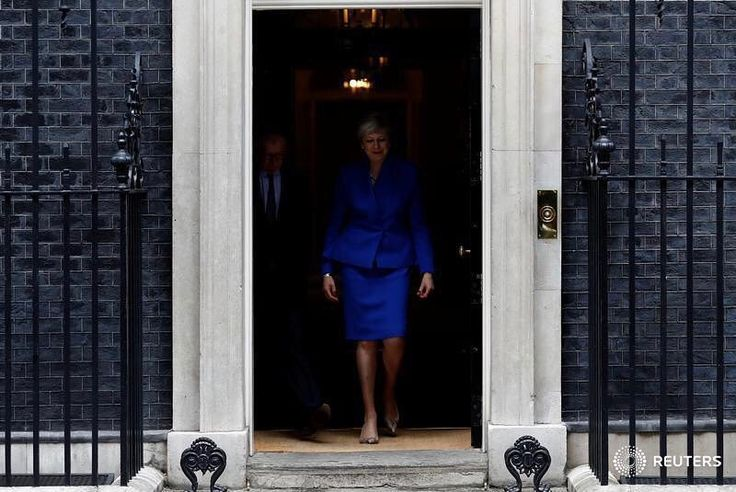 Britain's Primer Minister Theresa May leaves Downing Street on her way to Buckingham Palace after Britain's election in London, Britain June 9, 2017. May will form a government supported by a small Northern Irish party after her Conservative Party lost its parliamentary majority in an election debacle days before talks on Britain's EU departure are due to begin. A stony-faced May, speaking on the doorstep of her official Downing Street residence, said the government would provide certainty…