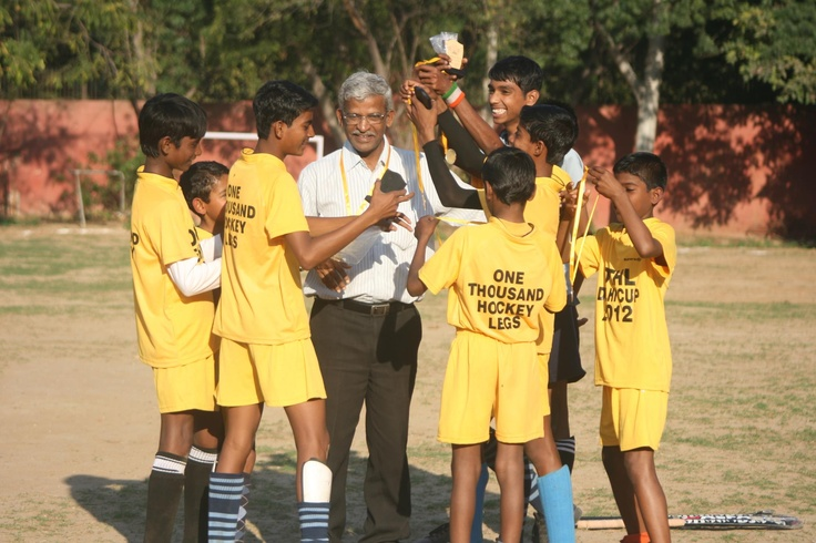 My NGO player-kids, who won a tournament recently, garland me with their gold medals in a surprise move. Thank you my boys, like your company all the time.
