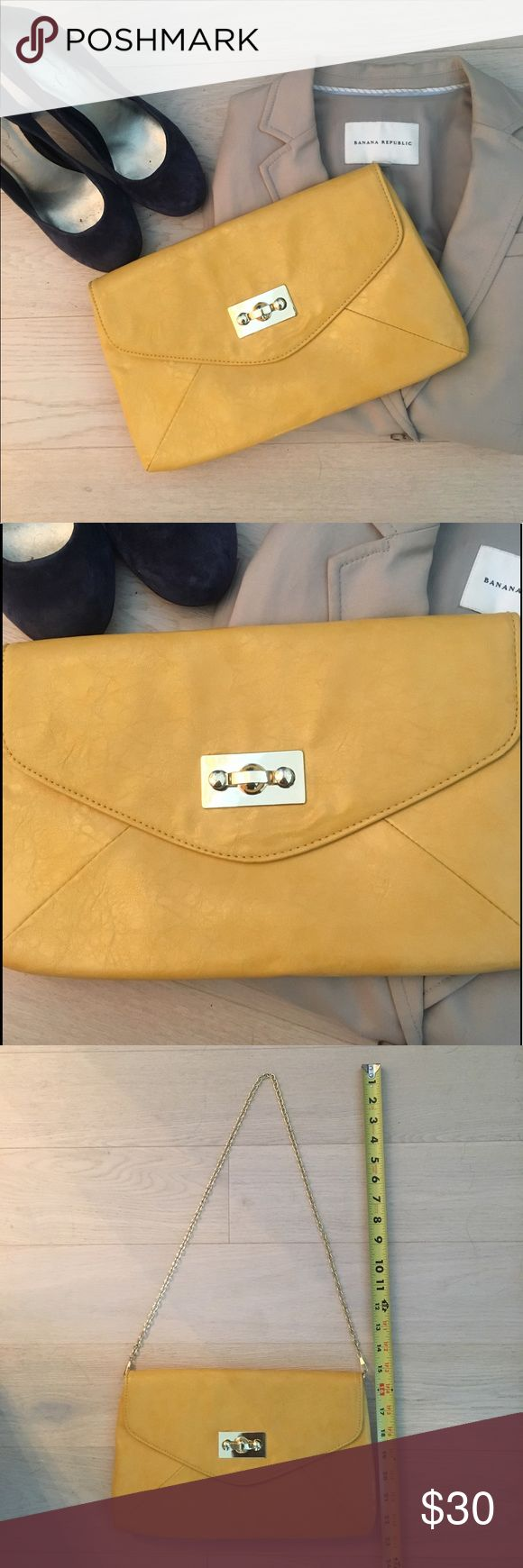Yellow Clutch Bag with Chain Strap - Aldo • Aldo yellow clutch bag with chain strap • Gold hardware details • Chain can be tucked into bag to use it as a clutch • One interior zipper pocket • Good condition Aldo Bags