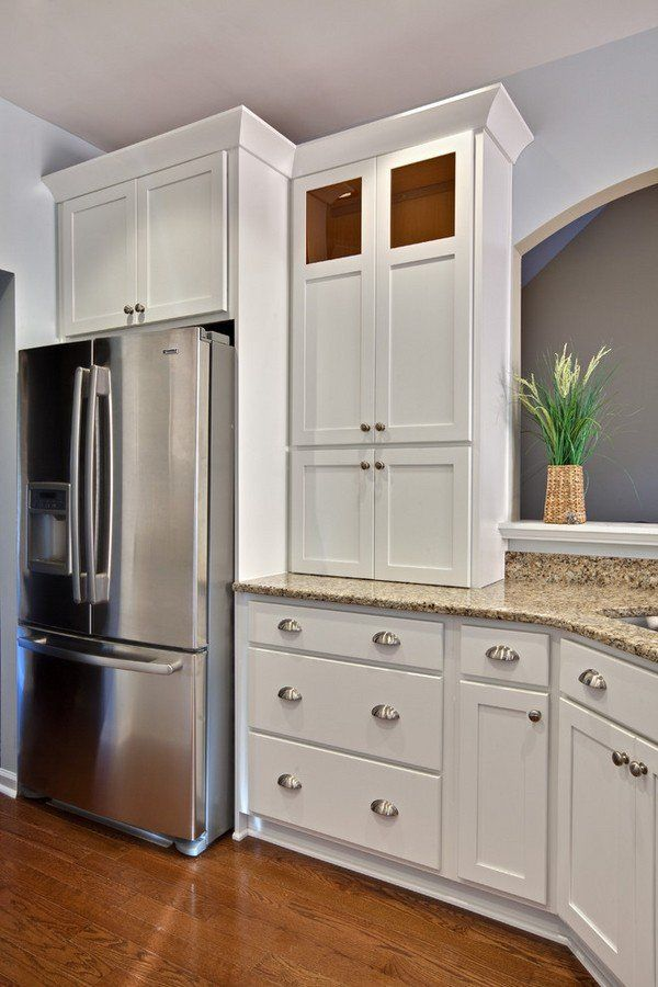 white shaker cabinets silver hardware Santa Cecilia granite countertop hardwood flooring