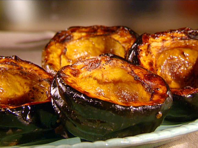 Sweet Roasted Acorn Squash recipe that'll turn anyone into a squash-lover. And so easy, your husband could make it! Bakes for 1hr 15min at 450.