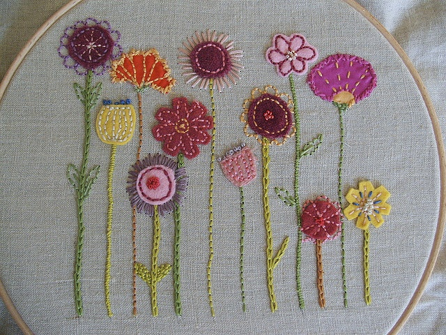 embroidered flowers Lots of stitching on this board