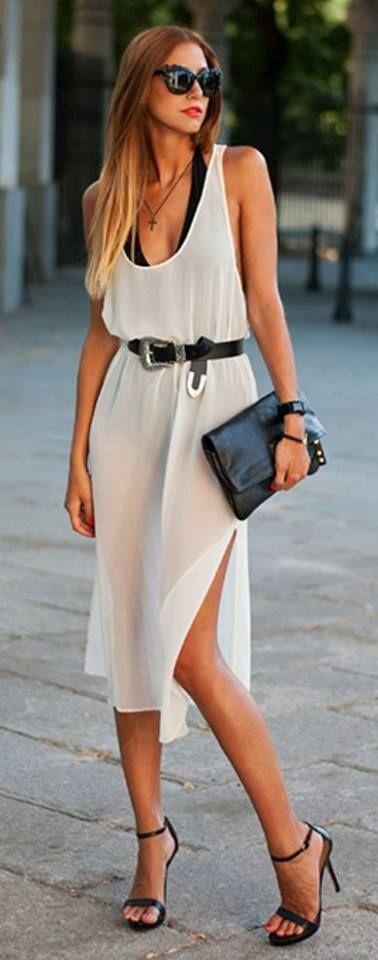 Acheter la tenue sur Lookastic: https://lookastic.fr/mode-femme/tenues/robe-debardeur-sandales-a-talons-pochette-ceinture-lunettes-de-soleil-montre/12501 — Robe débardeur en soie blanche — Ceinture en cuir noire — Montre en caoutchouc noire — Pochette en cuir noire — Sandales à talons en cuir noires — Lunettes de soleil noires