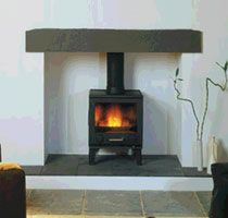 log burner: Slate hearth, stone mantle
