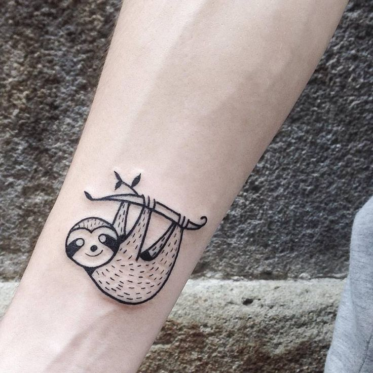 Illustrative sloth tattoo on the right inner forearm. Tattoo artist: Numi