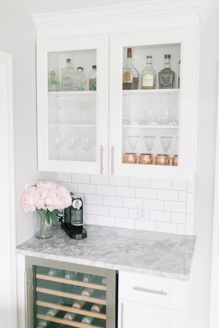 A Bright + Light Kitchen Renovation | Wine bar and glass cabinets