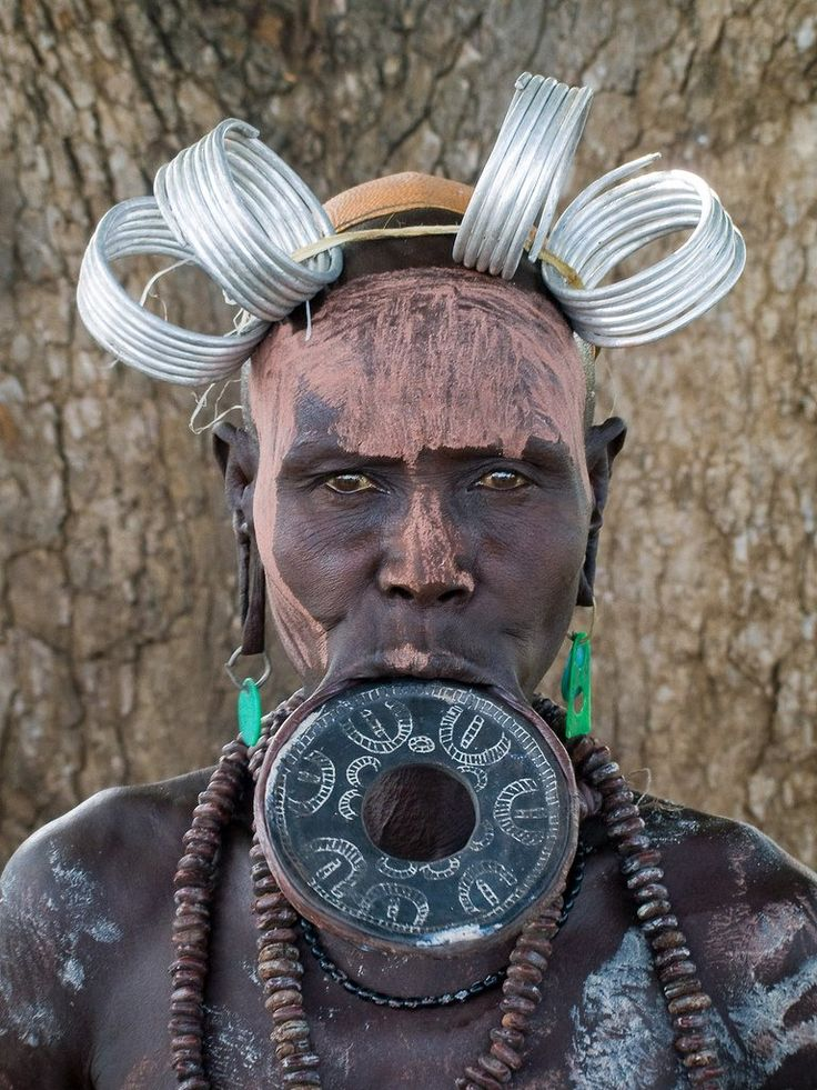 The Mursi tribe are an African tribe from the isolated Omo valley in Southern Ethiopia near the border with Sudan. There are an estimated 10,000 people in the Mursi tribe. The Mursi are sedentary rather than nomadic. The Mursi have their own language called Mursi, which is classified as one of the Surmic languages. The Mursi have a reputation for being one of the more aggressive African tribes and are famous for their stick fighting ceremony donga.