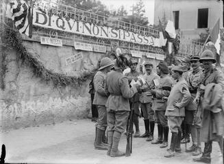 "THE ALLIED ARMIES ON THE ITALIAN FRONT, 1917-1918  Group of Allied troops in a street, 14 July 1918. Note the Allied motto in Italian reading: ""Di qui non si passa - This is not to be passed"". Photograph possibly taken in Granezza during the celebrations after the victorious Battle of the Piave River."