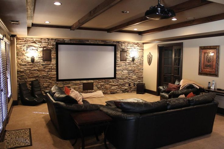 Decorations:Attractive Vintage Media Room Design Wooden Beam Ceiling Black Leather Sofa Exposed Stone Wall Cool Wall Lamp White Movie Screen Cream Concrete Floor Small Media Room Design Ideas: Perfect Features to Enhance Theater Atmosphere in the Room
