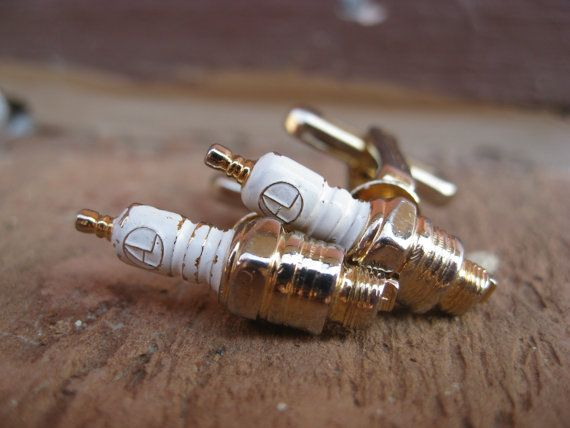 These vintage cufflinks would be perfect to give to a mechanic! Each cufflink is a goldtone and has a gold and white spark plug on the front, with the initials AL! The spark plug measures 1 long. They were made in the 1970s and are super cool. Theyre in good condtion, with just a little bit of wear to the white enamel.    These would be great for any time of the year! They are wonderful cufflinks for St. Patricks Day, a wedding, for a groomsmen gift, for Fathers Day, or a birthday.    This…