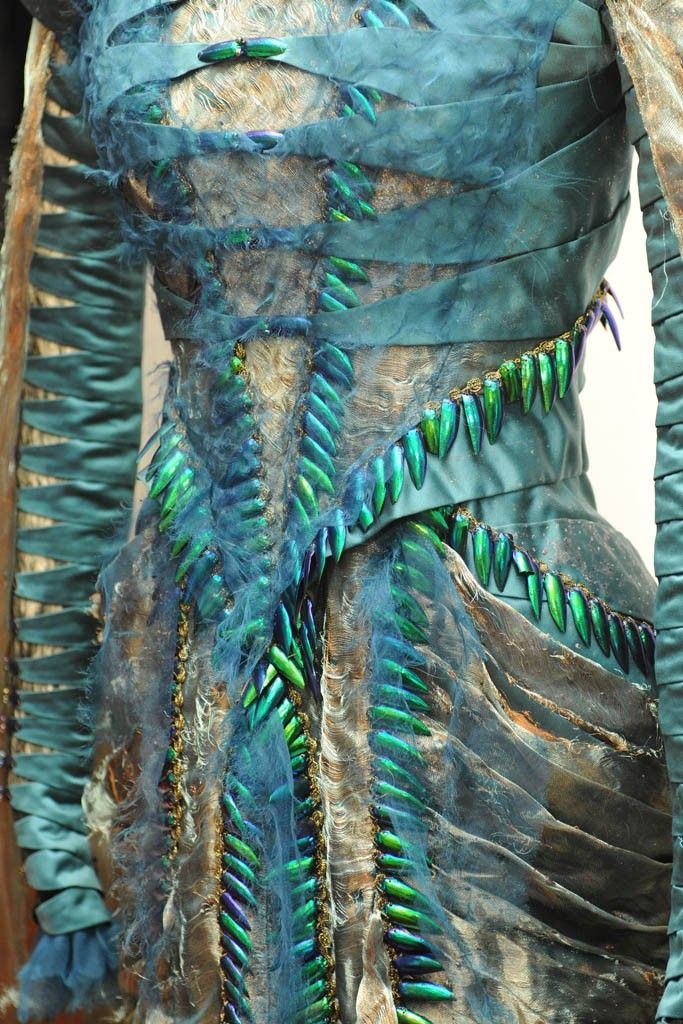 A detail of the beetle-wing dress made with silk taffeta and shreds of silk chiffon worn by Charlize Theron's Queen Ravenna.