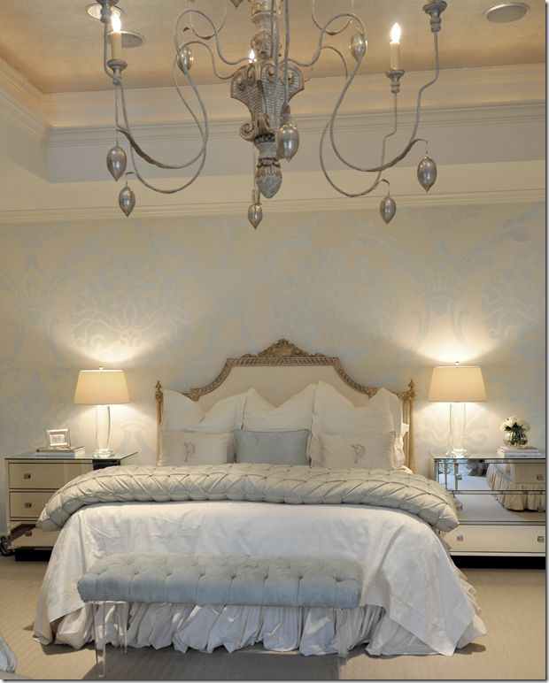 Master bedroom - would change the blue tones  to greyed lavender.  Over-sized chandelier, mirrored chests with crystal lamps