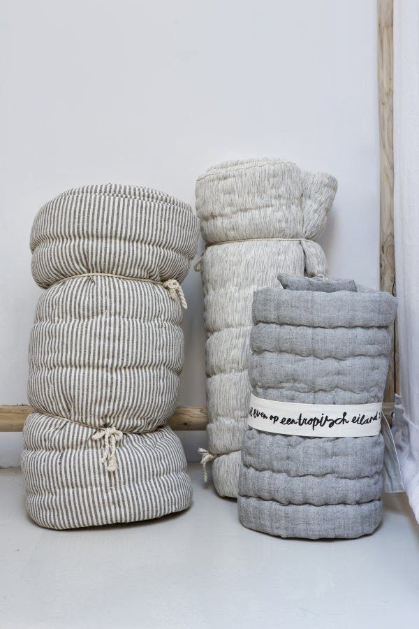 Ticking matress rolls for extra beds or comfort on top of a matress.