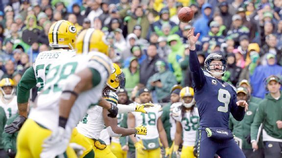 Punter Jon Ryan throws his first TD pass on a fake FG attempt to lineman Garry Gilliam.