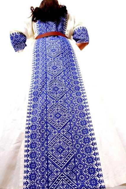Azure on white, truly amazing embroidery on the back of a Palestinian dress
